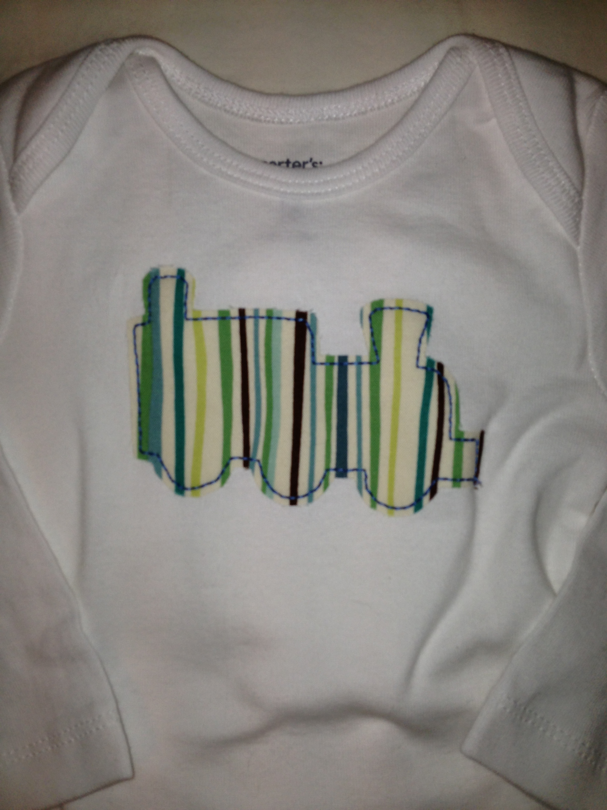 What baby boy wouldn't want to adorned with trains, planes and automobiles?  This makes a great baby shower gift. All the onesies are different sizes to  be ...